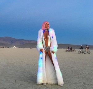 pink haired chick at burning man with long white coat