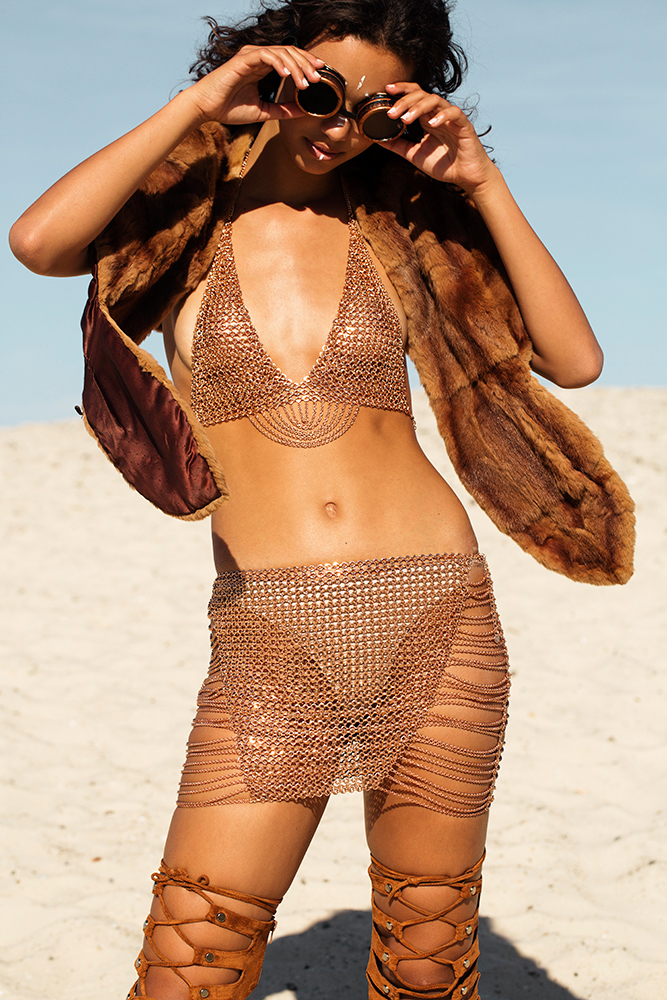 burning man x mad max festival fashion photo shoot in chain mail metal skirt