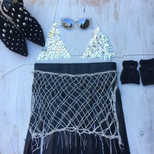 Burning man festival inspiration.A sneak look at our new chain mail bralette crop. Layered with the new chain mail scarf. Add some hot pants, a fishnet top, and don't forget the googles! Burning man festival inspiration.