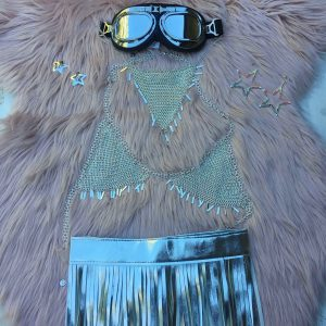 Pink faux fur, team it with Minka chain bralette and this epic We Are Submarine silver tassel skirt. Add some stars to your hair and googles to your head, Burning man ready.